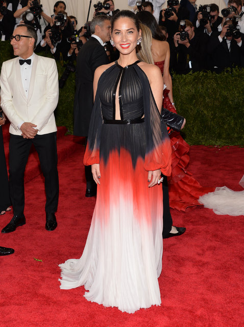 "Olivia Munn arrives at The Metropolitan Museum of Art's Costume Institute benefit gala celebrating ""China: Through the Looking Glass"" on Monday, May 4, 2015, in New York. (Photo by Evan Agostini/Invision/AP Photo)"