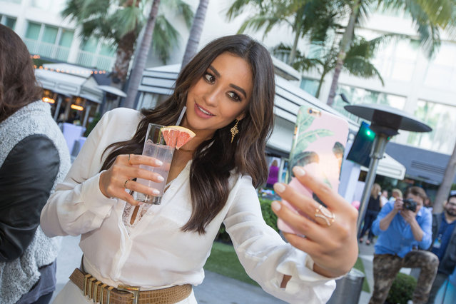 Actress and host Shay Mitchell snaps a selfie at the launch party for Palm Breeze, a new sparkling alcohol spritz from Mike's Hard Lemonade, Co., at the Viceroy Santa Monica, Saturday, April 25, 2015 in Santa Monica, Calif. Image released on Wednesday, April 29th, 2015. (Photo by Jeff Lewis/AP Images for Palm Breeze)