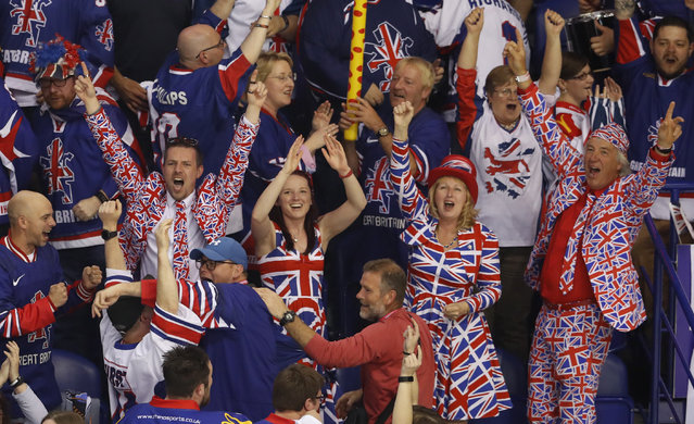 Fans of Great Britain celebrate after their team scored their first goal during the Ice Hockey World Championships group A match between Germany and Great Britain at the Steel Arena in Kosice, Slovakia, Saturday, May 11, 2019. (Photo by Petr David Josek/AP Photo)