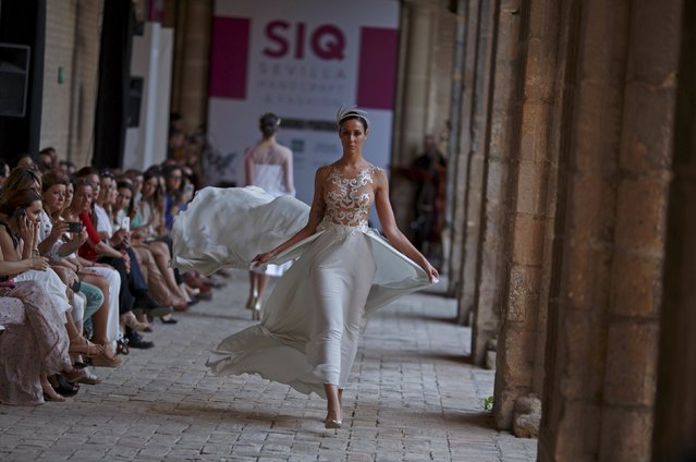 "A model presents a creation by Alejandro Postigo during ""SIQ, Sevilla Handcraft and Fashion"" in the Andalusian capital of Seville, southern Spain May 14, 2015. (Photo by Marcelo del Pozo/Reuters)"