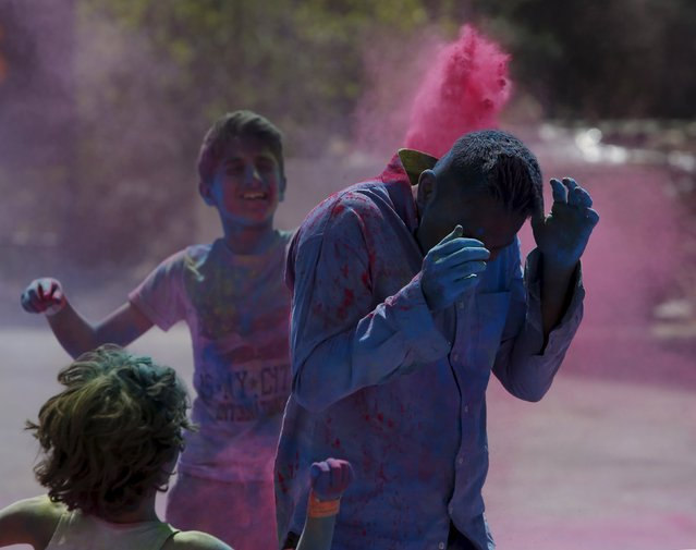 Participants throw coloured powder during the Holi Festival of Colours organised by the Maltese-Indian community in Qormi, outside Valletta, Malta, March 31, 2016. (Photo by Darrin Zammit Lupi/Reuters)