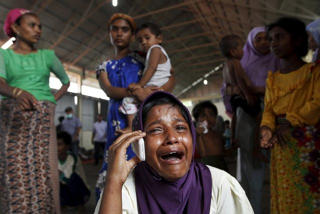 A Rohingya migrant who arrived in Indonesia by boat cries while speaking on a mobile phone with a relative in Malaysia, at a temporary shelter in Kuala Langsa in Indonesia's Aceh Province May 16, 2015. (Photo by Roni Bintang/Reuters)
