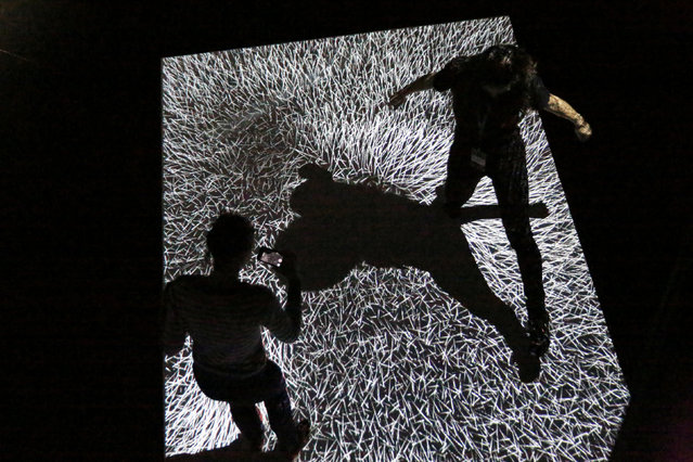 """Visitors interact with """"Field of Vectors"""", created by Adrien M & Claire B, which is featured part of Teknopolis, a participatory arts-tech exhibit at the Brooklyn Academy of Music (BAM) in Brooklyn, New York, U.S., February 25, 2017. (Photo by Ashlee Espinal/Reuters)"""