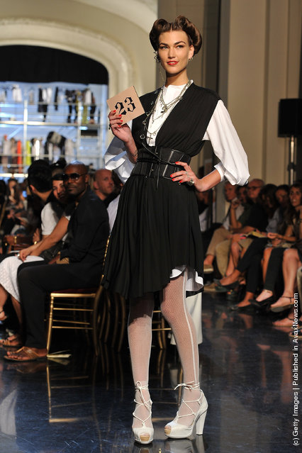 A model walks the runway during the Jean Paul Gaultier Ready to Wear Spring / Summer 2012 show during Paris Fashion Week