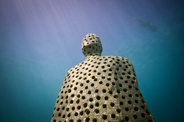"""Holy man"". Underwater Sculpture, Museo Subacuático de Arte, Cancun. (Photo by Jason deCaires Taylor/UnderwaterSculpture)"