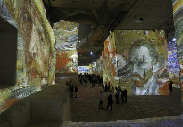 People attend an exhibition of projections of the most famous works of art by Vincent van Gogh at Carrieres de Lumiere in Les Baux-de-Provence, France on June 15, 2019. (Photo by Action Press/Rex Features/Shutterstock)