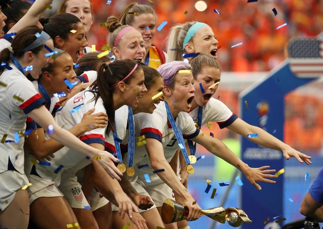 United States players celebrate their victory after the Women's World Cup final soccer match between US and The Netherlands at the Stade de Lyon in Decines, outside Lyon, France, Sunday, July 7, 2019. US won 2:0. (Photo by Denis Balibouse/Reuters)