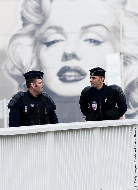 Police officers patrol a bridge ahead of the G20 Summit