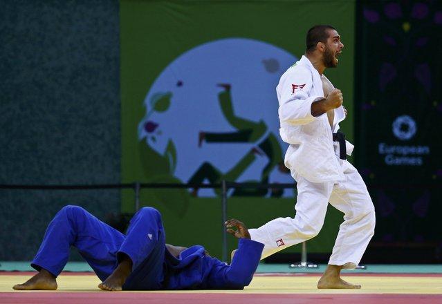 Toma Nikiforov of Belgium celebrates after winning his men's judo under 100kg bronze medal fight against Jorge Fonseca of Portugalat the 1st European Games in Baku, Azerbaijan, June 27, 2015. (Photo by Stoyan Nenov/Reuters)