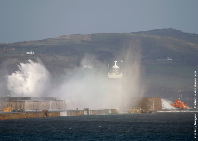 A lifeboat passes by the Holyhead breakwater as the search continues for the crew of cargo vessel The Swanland, which sank off north Wales on November 27, 2011 in Holyhead, Wales