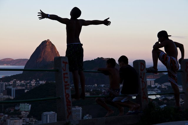 An exhibition at London's Horniman Museum by three photographers from Brazil's largest favela, Maré, shows us their unique vision of Rio de Janeiro. Here: A boy and the Sugarloaf Mountain. View from Morro dos Prazeres, a favela in the south of Rio. (Photo by Elisângela Leite/Horniman Museum)