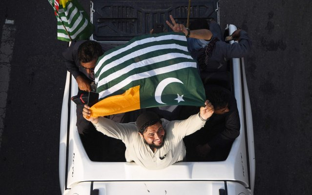 A man waves a Pakistan-administered Kashmir flag as he takes part in Independence Day celebrations in Karachi on August 14, 2019, as the nation marks the 73rd anniversary of independence from British rule. (Photo by Asif Hassan/AFP Photo)