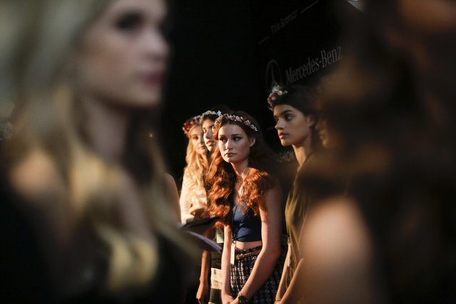 Models attend the rehearsal for the Lena Hoschek Spring/Summer 2016 fashion show during the Mercedes-Benz Fashion Week in Berlin, Germany, Tuesday, July 7, 2015. (Photo by Markus Schreiber/AP Photo)