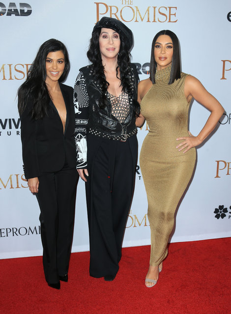 """Kim Kardashian West, Cher and Kourtney Kardashian attend the premiere of Open Road Films' """"The Promise"""" on April 12, 2017 in Hollywood, California. (Photo by Splash News and Pictures)"""