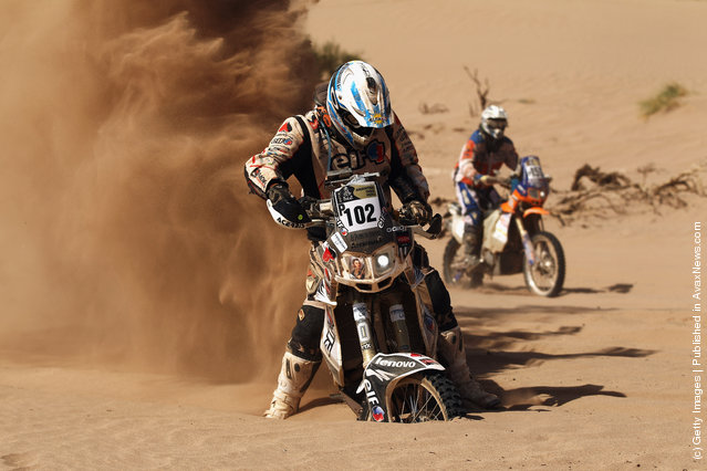Eduardo Alan of Argentina and Pampa Racing gets his Yamaha motorbike stuck in the sand during stage five of the 2012 Dakar Rally