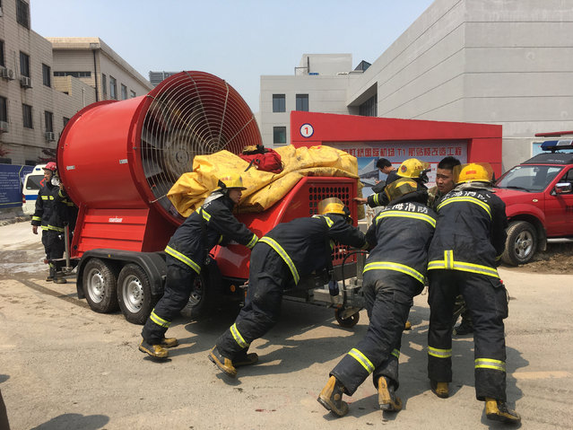 Firefighers are seen near the site of a fire at the Shanghai Hongqiao Airport in Shanghai April 29, 2016. (Photo by Reuters/Stringer)