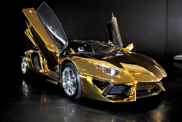 A replica model of a Lamborghini Aventador LP 700-4 in Dubai, UAE. This is the world's most expensive model car, made from carbon fibre and covered in a thin layer of pure gold. (Photo by Robert Gulpen/Barcroft Media)