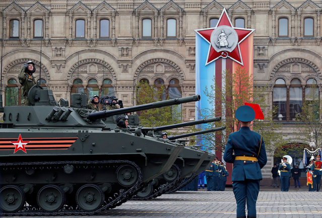 Russian servicemen parade with tanks during the 72nd anniversary of the end of World War II on the Red Square in Moscow, Russia on May 9, 2017. (Photo by Sergei Karpukhin/Reuters)