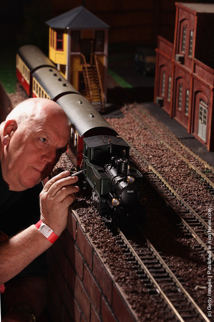 Fraser Nielson adjusts a G scale locomotive model as enthusiasts gather for the Rail Scotland exhibition