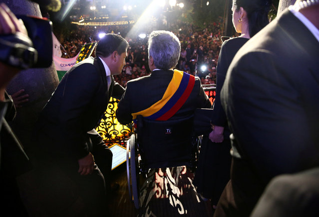Ecuador's President Lenin Moreno greets supporters  from the government palace's balcony after his inauguration ceremony in Quito Ecuador, May 24, 2017. (Photo by Mariana Bazo/Reuters)