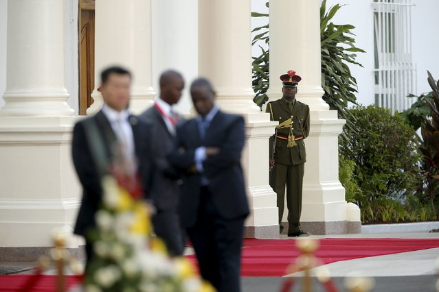 A ceremonial guard (R) looks on as U.S. President Barack Obama and Kenya's President Uhuru Kenyatta (neither pictured) hold a joint news conference after their meeting at the State House in Nairobi July 25, 2015. (Photo by Jonathan Ernst/Reuters)