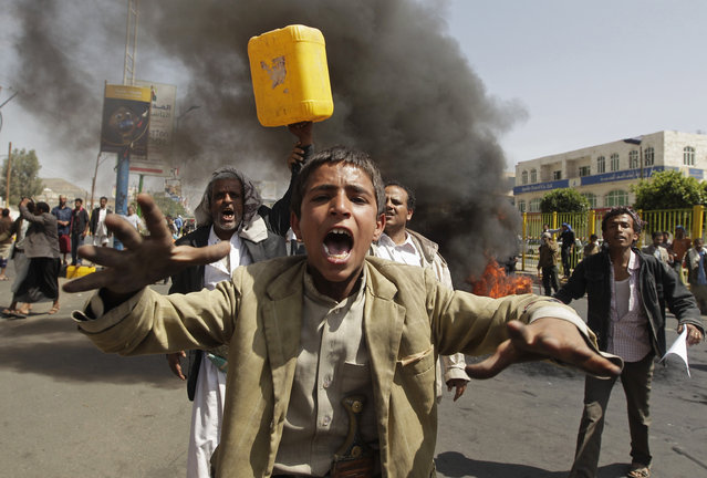 Protesters demonstrating against Yemen's fuel shortages shout slogans in Sanaa June 11, 2014. (Photo by Khaled Abdullah/Reuters)