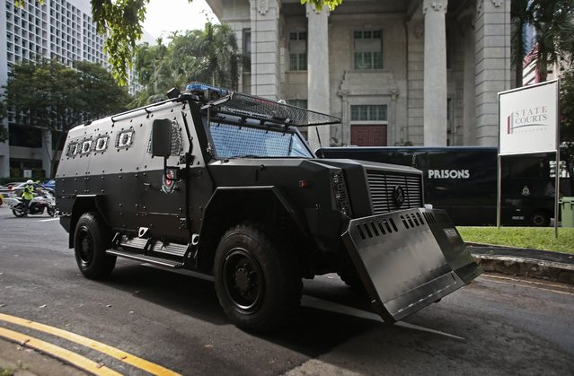 An armored police van carrying detained Bangladeshi nationals, from a group of eight, turns into the State Court in Singapore, 31 May 2016. Of the group, two members have been deported and the remaining six are to be prosecuted under the Terrorism (Suppression of Financing) Act (TSOFA) and have been charged in court for providing, collecting and possessing property in relation to terrorism. Two will also be charged for possession of property for terrorist purposes under the same Act. (Photo by Wallace Woon/EPA)
