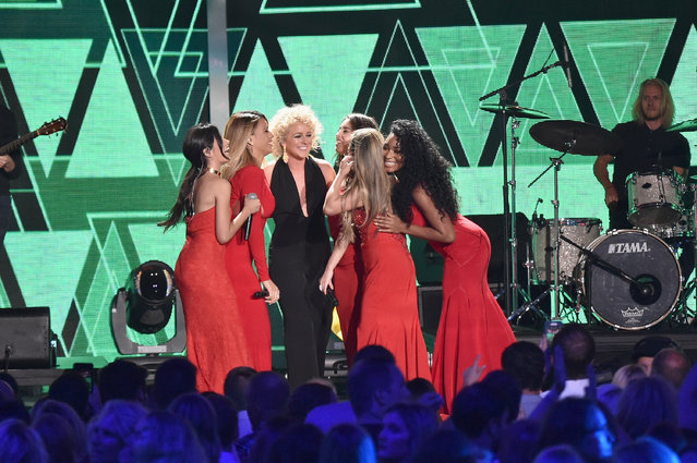 Ally Brooke, Normani Kordei, Dinah Jane, Camila Cabello, and Lauren Jauregui from musical group Fifth Harmony and singer-songwriter Cam onstage during the 2016 CMT Music awards at the Bridgestone Arena on June 8, 2016 in Nashville, Tennessee. (Photo by Mike Coppola/Getty Images for CMT)