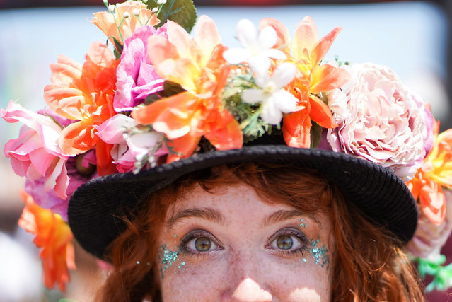 A woman with an elaborate hat poses during Glastonbury Festival at Worthy farm in Somerset, Britain on June 27, 2019. (Photo by Henry Nicholls/Reuters)