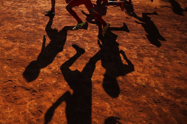 """Young players of Planaltina football club practise in Planaltina July 3, 2014. In a project called """"On The Sidelines"""" Reuters photographers share pictures showing their own quirky and creative view of the 2014 World Cup in Brazil. (Photo by Damir Sagolj/Reuters)"""