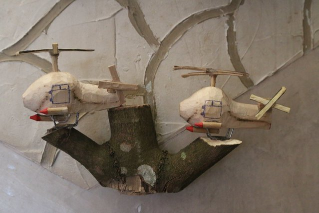 Wooden helicopters carved by Abu Khalil, a 47-year-old Free Syrian Army fighter who is also a visual artist and decorator, are displayed at his workshop in Jabal al-Turkman in Latakia province January 20, 2015. (Photo by Alaa Khweled/Reuters)