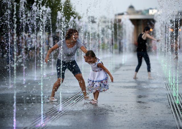 People play while cooling off in a fountain at Gorky park in Moscow, Russia, August 9, 2015. (Photo by Sergei Karpukhin/Reuters)