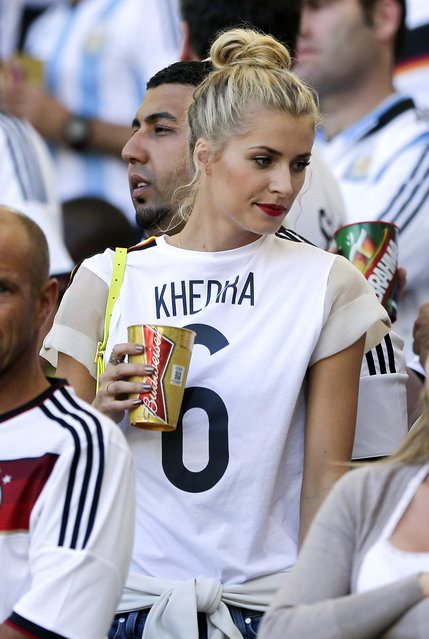 Lena Gercke, the girlfriend of Germany's Sami Khedira, waits for the start of the World Cup final soccer match between Germany and Argentina at the Maracana Stadium in Rio de Janeiro, Brazil, Sunday, July 13, 2014. (Photo by Matthias Schrader/AP Photo)