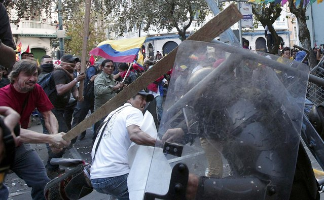 Demonstrators clash with the police during a march in Quito, Ecuador, August 13, 2015. (Photo by Guillermo Granja/Reuters)
