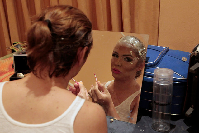 """A participant gets ready backstage before the start of the """"Miss Gay Nicaragua 2016"""" beauty pageant in Managua, Nicaragua June 25, 2016. Picture taken June 25, 2016. (Photo by Oswaldo Rivas/Reuters)"""
