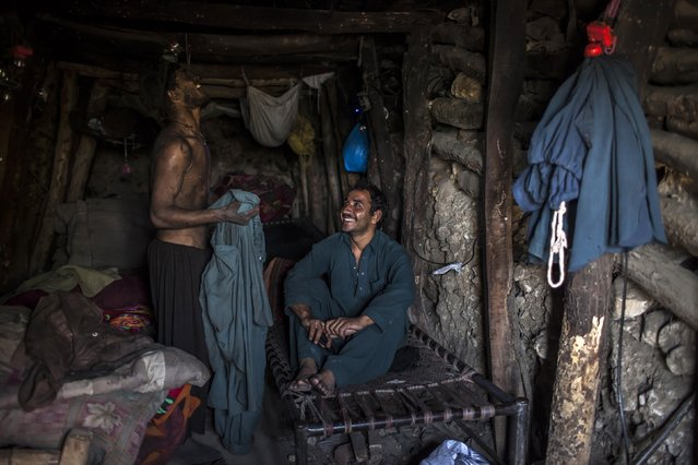 Miners rest in their rooms at the end of the day at a coal field in Choa Saidan Shah, Punjab province, April 29, 2014. (Photo by Sara Farid/Reuters)
