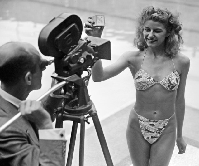 For the election of the most beautiful bather, a candidate appears for the first time wearing a bikini, 05 July 1946 at the Molitor swimming-pool in Paris. Real clothing revolution, the bikini, a two-piece swimming suit, has been designed by French Louis Reard. (Photo by AFP Photo)