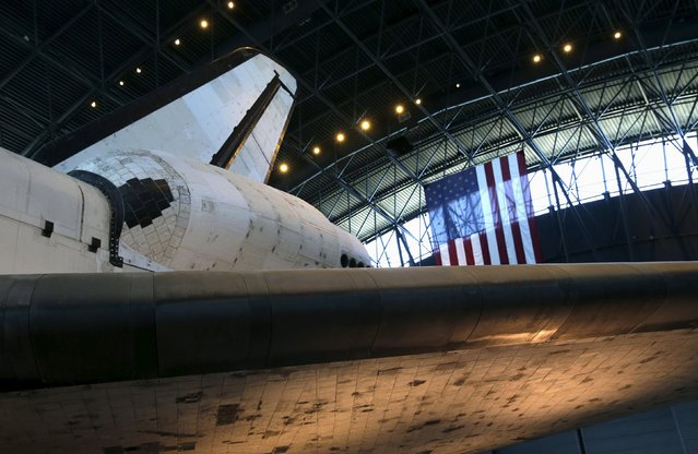 The fuselage, and heat tiles (bottom), under the wing of the space shuttle orbiter Discovery are seen on display at the Udvar-Hazy Smithsonian National Air and Space Annex Museum in Chantilly, Virginia August 28, 2015. (Photo by Gary Cameron/Reuters)