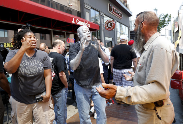 Protesters argue religion in downtown Cleveland on Tuesday, July 19, 2016, during the second day of the Republican convention. (Photo by Alex Brandon/AP Photo)