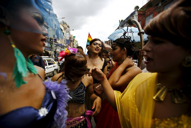 Revellers dance while taking part in a LGBT (lesbian, gay, bisexual, and transgender) pride parade to mark Gaijatra Festival, also known as the festival of cows, in Kathmandu, Nepal August 30, 2015. (Photo by Navesh Chitrakar/Reuters)