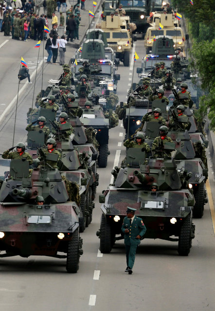 Soldiers pass by in a military vehicle during a military parade to celebrate the 206th anniversary of Colombia's independence in Bogota, Colombia, July 20, 2016. (Photo by John Vizcaino/Reuters)