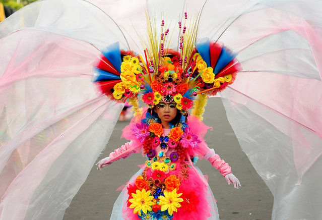 A model wears a chemistry inspired costume in the kids carnival during The 13th Jember Fashion Carnival 2014 on August 21, 2014 in Jember, Indonesia. (Photo by Robertus Pudyanto/Getty Images)