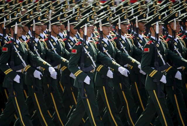 Paramilitary policemen march during the military parade marking the 70th anniversary of the end of World War Two, in Beijing, China, September 3, 2015. (Photo by Damir Sagolj/Reuters)