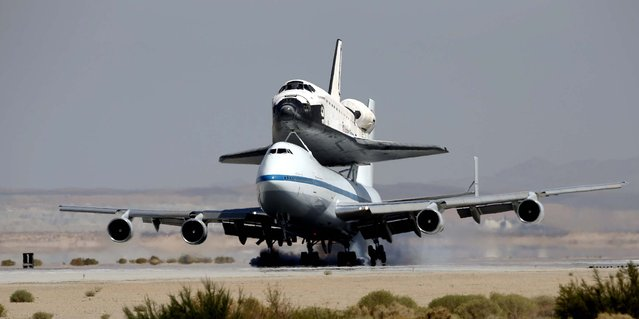 Space shuttle Endeavour mounted on NASA's Shuttle Carrier Aircraft (SCA) lands at Edwards Air Force Base, California on Thursday. (Photo by Jae C. Hong/Associated Press)