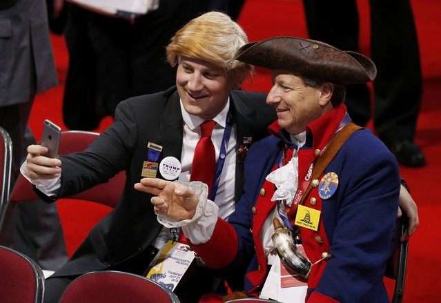 Delegates dressed as Donald Trump and an American Revolution soldier take a selfi at the Republican National Convention in Cleveland, Ohio, U.S. July 21, 2016. (Photo by Mario Anzuoni/Reuters)