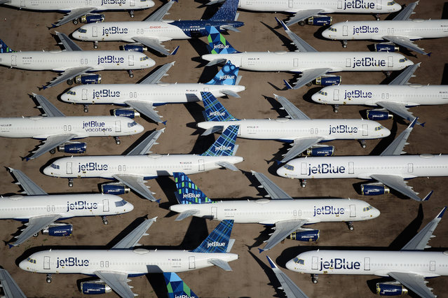 Decommissioned and suspended jetBlue commercial aircrafts are seen stored in Pinal Airpark on May 16, 2020 in Marana, Arizona. Pinal Airpark is the largest commercial aircraft storage facility in the world, currently holding increased numbers of aircraft in response to the coronavirus COVID-19 pandemic. (Photo by Christian Petersen/Getty Images)