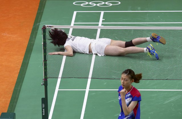 2016 Rio Olympics, Badminton, Mixed Doubles Group Play, Riocentro, Pavilion 4, Rio de Janeiro, Brazil on August 13, 2016. Ayane Kurihara (JPN) of Japan lies on the court during play with Kenta Kazuno (JPN) of Japan against Kim Ha-Na (KOR) of South Korea and Ko Sung-Hyun (KOR) of South Korea. (Photo by Marcelo del Pozo/Reuters)