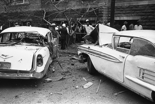The autos, which were parked beside the 16th street Baptist Church, were blown four feet by an explosion which ripped the church during services in Birmingham, Ala. on September 15, 1963. The explosion also blasted windows from buildings within the area. (Photo by AP Photo)