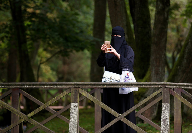 A tourist from the Middle East takes pictures at Vrelo Bosne nature park in Ilidza near Sarajevo, Bosnia and Herzegovina, August 19, 2016. (Photo by Dado Ruvic/Reuters)