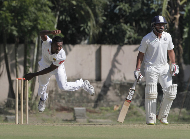 Sri Lanka's Vishwa Fernando, left, bowls a delivery on the second day of their two-day warm up cricket match against Indian Board President's XI in Kolkata, India, Sunday, November 12, 2017. (Photo by Bikas Das/AP Photo)